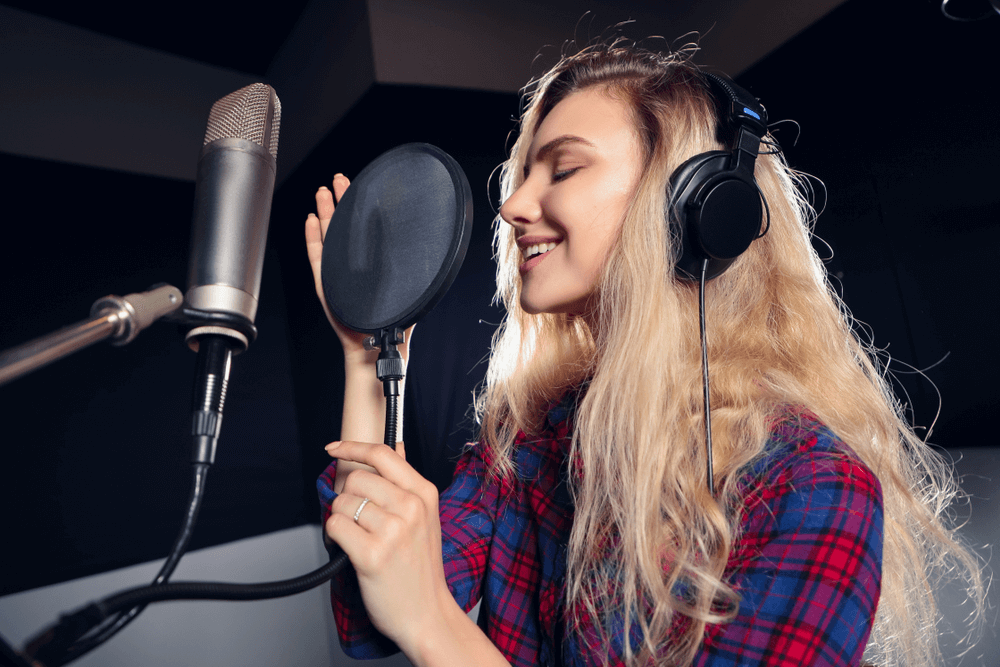 Why Do Musicians Wear Headphones While Recording